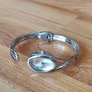 EUC hinged cuff silver watch